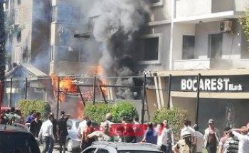بالصور| الحماية المدنية تحاول السيطرة على حريق فندق بالدُقي