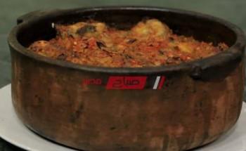 طريقة عمل طاجن سمك الثعابين المدفون بالأرز علي طريقة الشيف شربيني