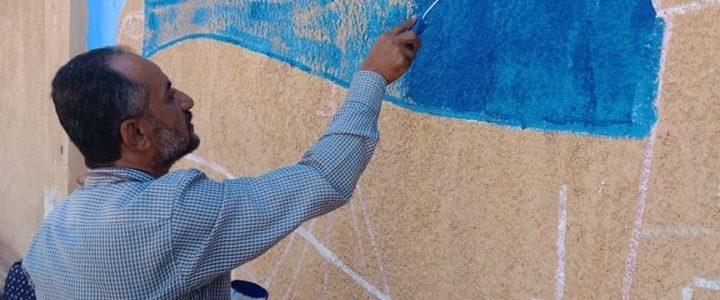 """رسم وتجميل سور محطة كهرباء عزبة البرج بدمياط لتنشيط السياحة تحت شعار """"صحبة فن"""""""