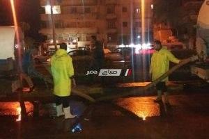 بالصور شفط تجمعات مياه الامطار من شارع مصطفى كامل الرأس السوداء