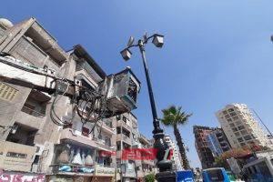 دهان الاعمده الديكورية بشارع الجمهوريه بالبحيرة للارتقاء الحضاري بشوارع المدينة