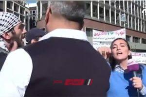 مندسين يحاولون الاعتداء على مذيعة لبنانية على الهواء.. فيديو